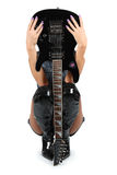 Guitar. Pair of legs in boots with electric guitar royalty free stock photography