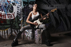 Sexy guitar player Stock Images