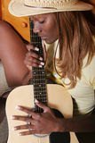 Guitarist. African American girl playing the guitar stock images