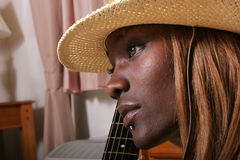 Guitarist. African American girl with her guitar royalty free stock image
