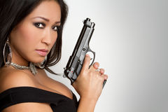 Sexy Gun Woman. Sexy asian woman holding gun Royalty Free Stock Photo