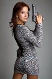 Gun Woman. Latina woman holding gun royalty free stock photo