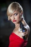 Gun woman. In retro look pointing gun royalty free stock photos