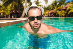 Sexy guy coming out of swimming pool Royalty Free Stock Images
