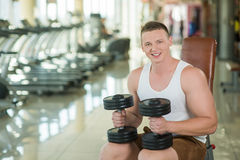 Sexy guy in gym. Stock Photos