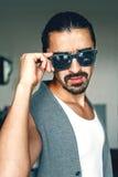 Sexy guy in sunglasses Stock Photos