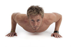 Sexy guy topless doing pressups Stock Image