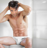 Sexy guy undressed Stock Photos