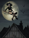 Sexy Halloween witch on broomstick Royalty Free Stock Images