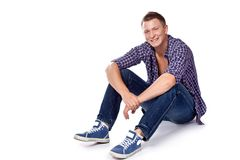 Sexy handsome macho posing in casual wear Royalty Free Stock Photo