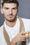 Sexy handsome man drinking white wine Stock Images