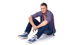Sexy handsome man posing in casual wear Royalty Free Stock Image