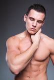 Sexy and handsome muscular man with closed eyes Stock Photo
