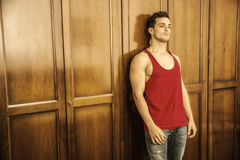 Sexy handsome young man in front of wardrobe Stock Images