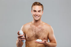 Sexy handsome young man with a shaving foam Royalty Free Stock Images