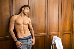 Sexy handsome young man standing shirtless Royalty Free Stock Photo