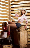 Sexy and happy cowgirl posing in a barn Stock Image