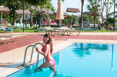 Sexy happy woman in bikini get out from swimming pool. Stock Images