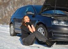 Sexy helpless woman sitting near broken car Stock Photos