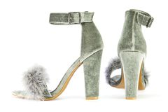 High heels with faux fur in gray. Sexy high heels shoes with ankle strap and fancy faux fake fur in gray suede, isolated on white background Royalty Free Stock Photo