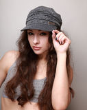 Sexy hip hop girl in trendy cap looking Stock Image