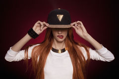 Sexy hiphop woman in cap Royalty Free Stock Image