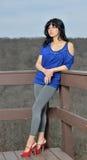 Sexy Hispanic female model posing in dress Stock Photos