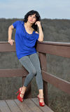 Sexy Hispanic female model posing in leggings and blue blouse Stock Images