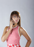 Sexy hispanic lady talking on cellular phone Stock Photos