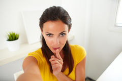 Sexy hispanic woman chatting on her phone Royalty Free Stock Photography