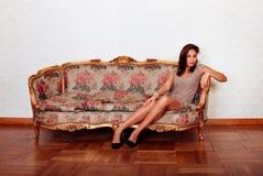 hispanic woman couching on sofa royalty free stock image