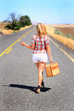 Sexy Hitch Hiker Thumbing Stock Image