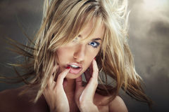 Sexy hot. Sexy blond woman outdoors with moving hairs Royalty Free Stock Photo