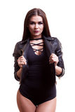 Sexy hot woman in body and leather jacket over white background Royalty Free Stock Image