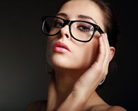 hot woman in glasses on black Royalty Free Stock Photography
