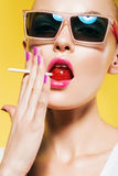 hot woman holding red lollipop in mouth Stock Images