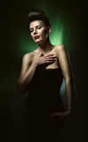 Sexy hot woman with red lips in dark green Royalty Free Stock Photography