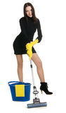 Sexy housewife. In elegant dress holding a swab and bucket, white background Stock Photography