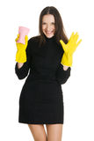 Sexy housewife. In elegant dress holding a swab and bucket, white background Stock Image