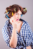 Housewife with curlers. Portrait of housewife with curlers royalty free stock photo