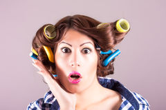 Housewife with curlers. Portrait of housewife with curlers stock photo