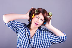 Sexy housewife with curlers Royalty Free Stock Image