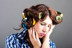 Housewife with curlers. Portrait of housewife with curlers stock photography