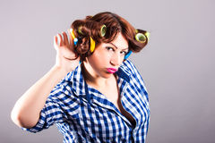 Housewife with curlers. Portrait of housewife with curlers royalty free stock photography