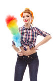 Sexy housewife holding a duster Stock Photography