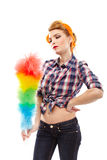 Sexy housewife holding a duster. Studio shot of young sexy housewife with hand on hip holding a duster, isolated over white back ground Royalty Free Stock Photos