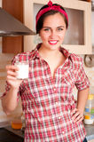 Sexy housewife holding glass Stock Photography