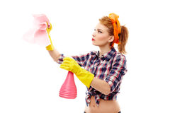 Sexy housewife holding a piece of cloth and a spray Stock Photos