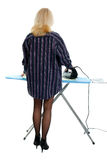 Sexy housewife ironing clothes Royalty Free Stock Images