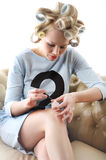 Sexy housewife painting nails. Royalty Free Stock Images